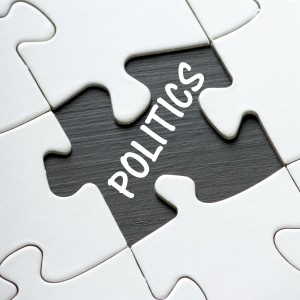The word Politics revealed by a missing jigsaw puzzle pieces